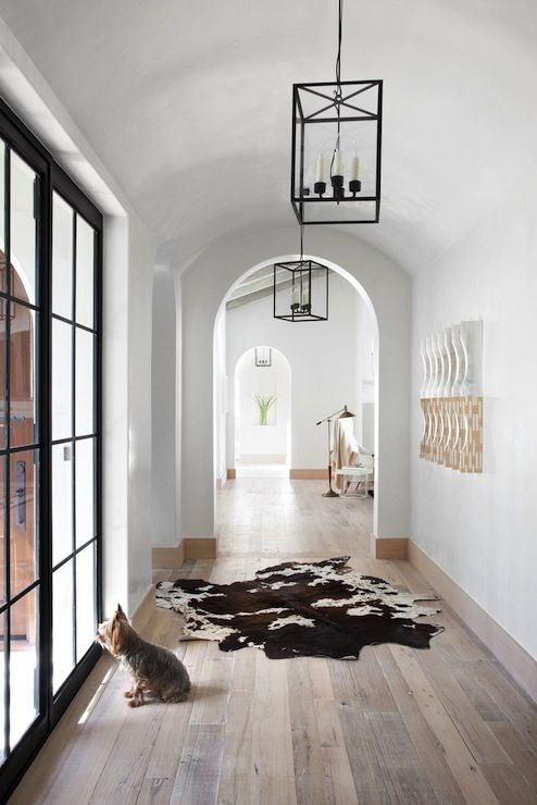arched doorways make entryways and corridors catchy and chic, add pendant lamps to highlight it