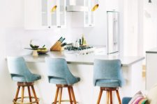 10 comfortable light blue upholstered chairs match the sofa and can be used both at the bar and anywhere else