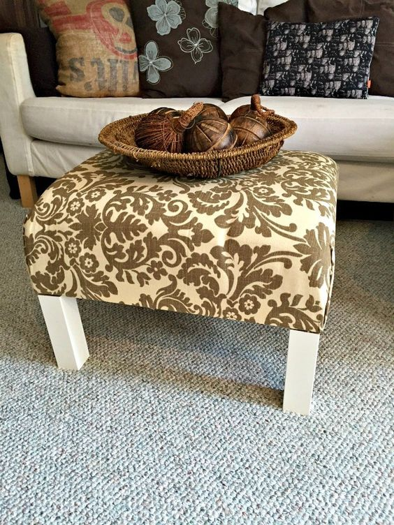 a plain and old IKEA Lack end table turned into a stylish ottoman with bright fabric on top
