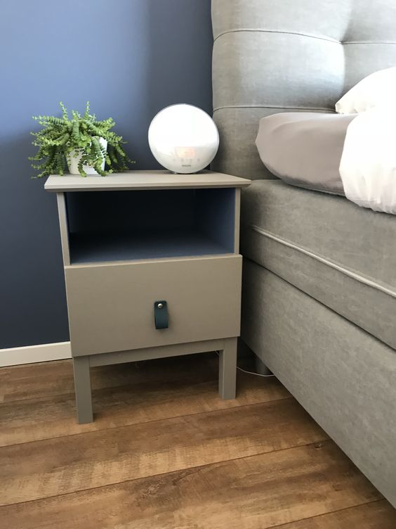 an IKEA Tarva nighstand painted grey and with a blakc leather pull is a simple makeover with plenty of style