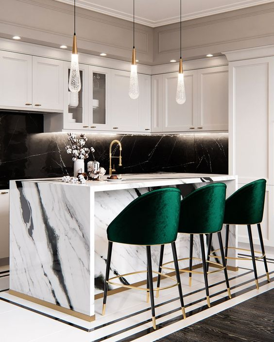 bold emerald stools with gold touches add color to the monochromatic kitchen and make the space cozier
