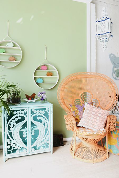 a bright orange peacock chair, a light blue cabinet will make your boho space very colorful and bright
