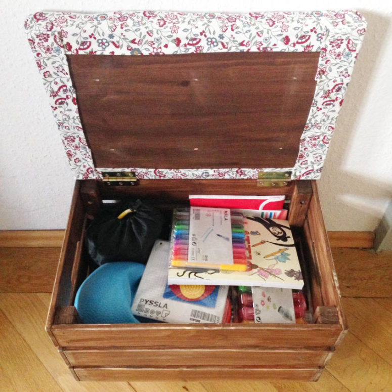 a simple and small ottoman of an IKEA Knagglig box with a top covered with bright floral fabric and storage inside