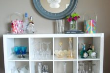 12 an IKEA Kallax shelving unit placed on legs is a cool idea with plenty of storage for all types of glasses