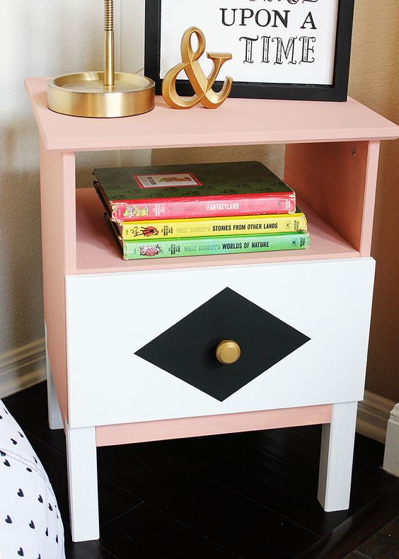 an IKEA Tarva nighstand in peachy pink, with geometric decor and a gilded knob is a bright idea