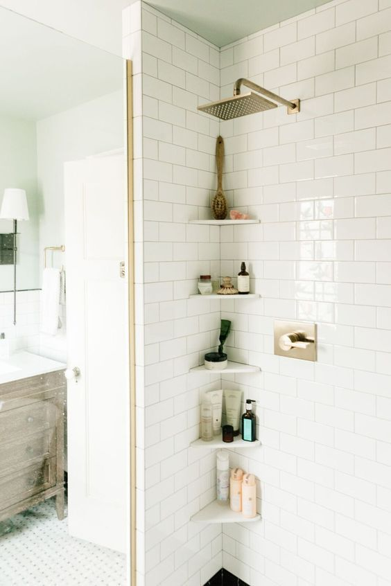 tiny corner shelves will literally save your life in a tiny shower space accommodating everything you need