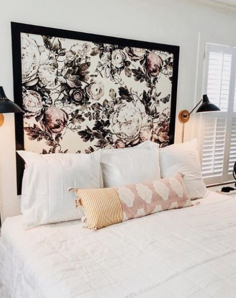 a headboard made of graphic floral wallpaper with a black frame is a very refreshing touch to the bedroom