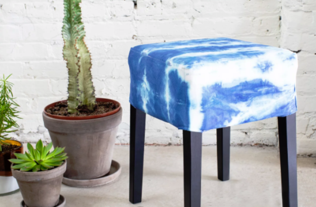a small ottoman done with an IKEA Nils cover and a shibori dye kit will add color and pattern to the space