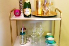 13 an IKEA Mulig shelving unit with contact paper and gold spray paint for a glam space