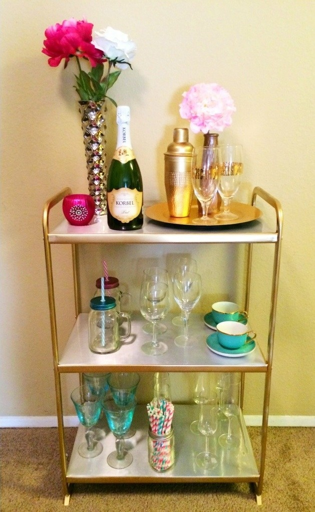 an IKEA Mulig shelving unit with contact paper and gold spray paint for a glam space