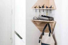 13 tiny geometric corner shelves with a key holder and some hooks are a great idea for a tiny entryway