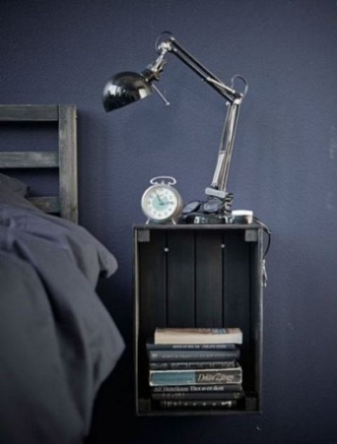 a Knagglig box painted grey and attached to the wall makes up a cool floating bedside table