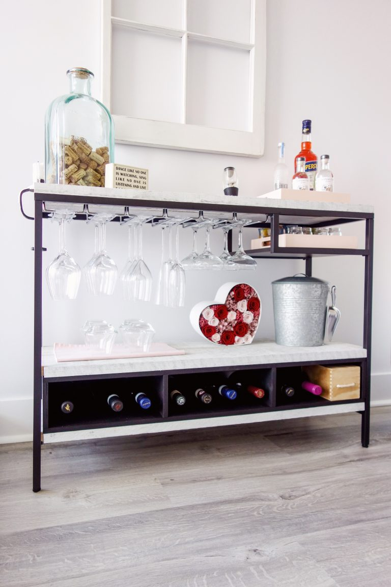 an IKEA Vittsjo hack into a stylish home bar with marble contact paper that covers plywood