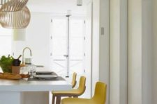 14 bright yellow stools bring a sunshine feeling to the kitchen and make your mood much better