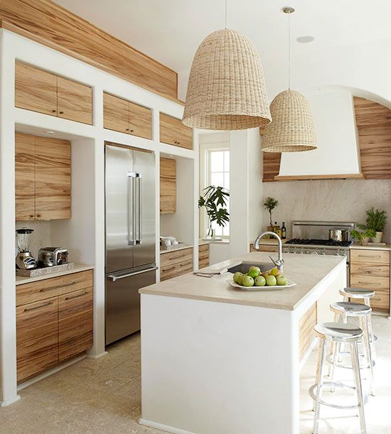 pendant wicker lamps and neutral plywood cabinets create a welcoming space with a rustic feel