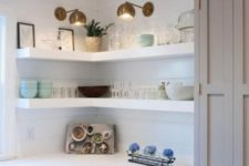 14 white thick corner shelves with additional spotlights are great to save some space in the kitchen