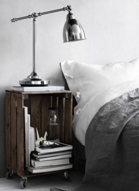 a stained Knagglig box placed on casters as a bedside table that can be moved anywhere and provides storage space