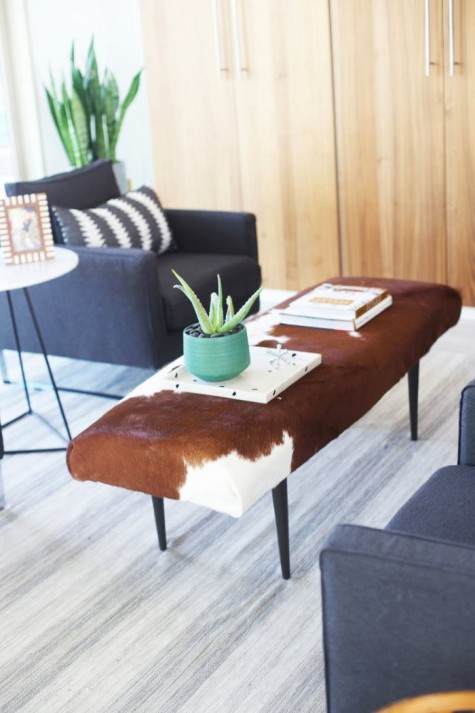 a stylish ottoman reupholstered with an IKEA Koldby Cowhide is a cool idea for a rustic or mid century modern space