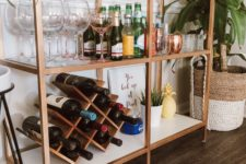 15 an IKEA Vittsjo shelving unit turned into a chic home bar with copper spray paint, the piece features much storage space