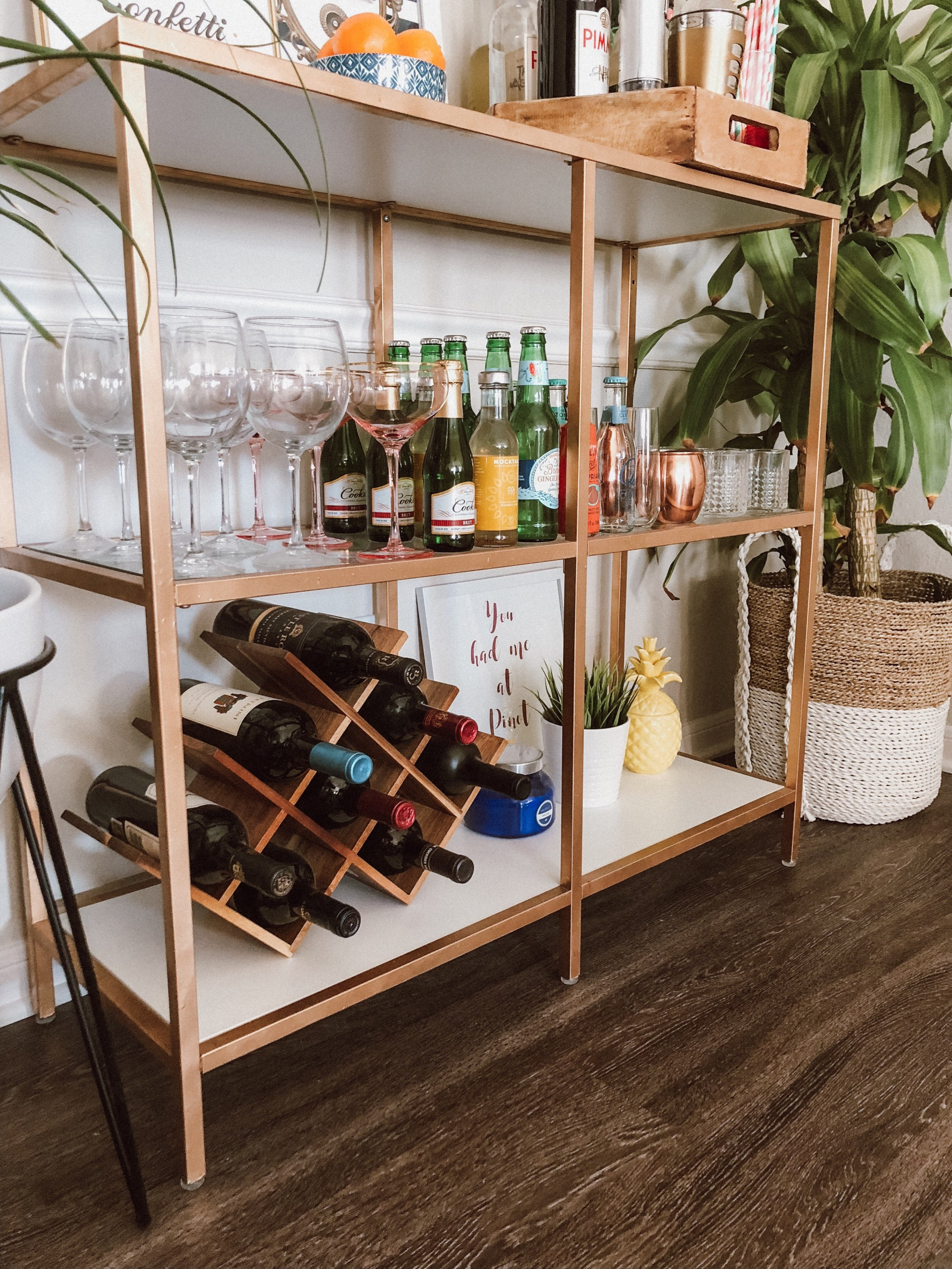 an IKEA Vittsjo shelving unit turned into a chic home bar with copper spray paint, the piece features much storage space