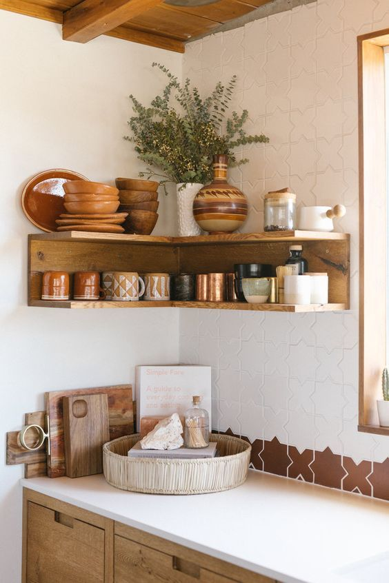 an open stained shelving unit in the corner will save much space for storing things
