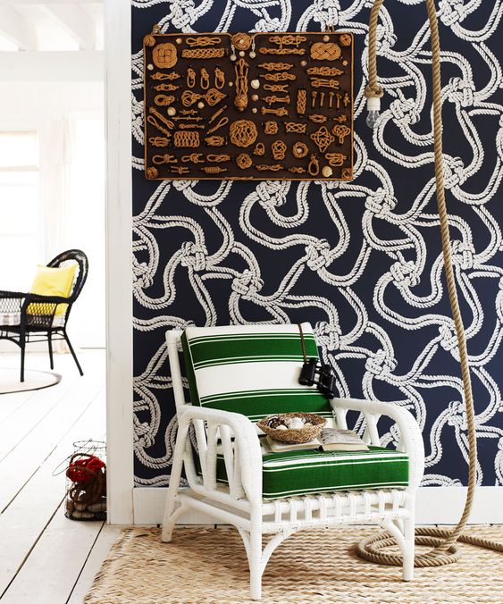 navy and white nautical statement wallpaper adds chic to the space and makes it feel like coasts