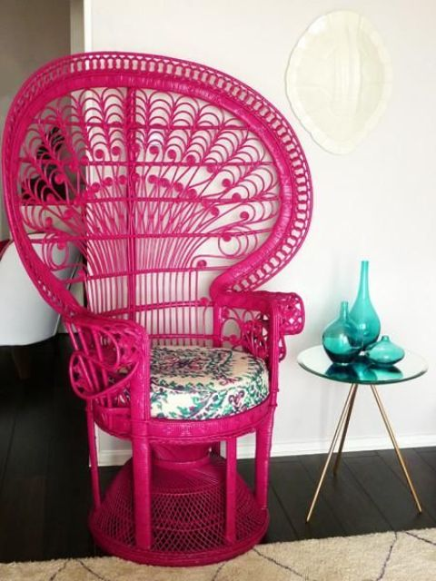 a hot pink peacock chair with a floral print cushion will not only add color but also a boho feel to the space
