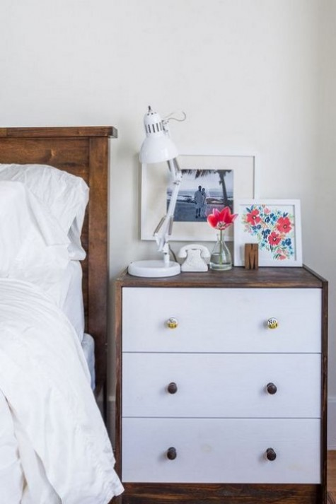 a stylish IKEA Rast hack – rich stained wood covering it and chic knobs for a bold nightstand