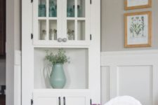 16 a vintage-inspired white corner cabinet is great for displaying all types of tableware and plates