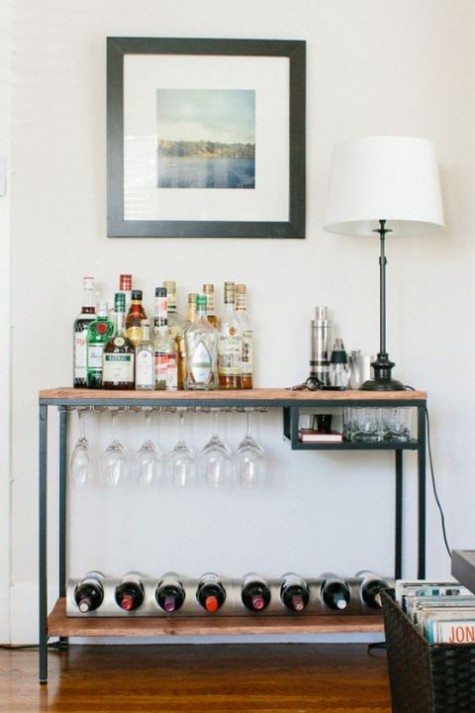 an IKEA Vittsjo table renovation into a rustic home bar with wooden countertops and a plenty of storage space