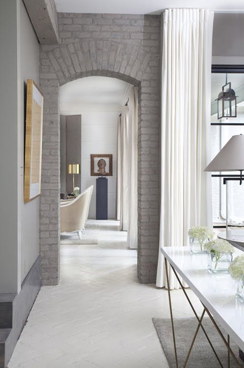 an arched doorway of paitned brick is a chic and stylish idea to spruce up a usual neutral space