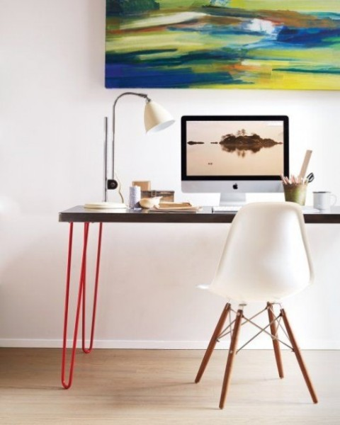 a modern lightweight looking desk made of an IKEA Sanfrid tabletop and bright red hairpin legs