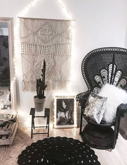 a monochromatic space in boho style with a black peacock chair looks very catchy and is non-traditional for this decor style