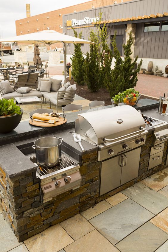a patio, an outdoor kitchen and a dining space for comfortable time outdoors and yummies
