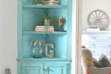 17 a turquoise shabby chic corner cabinet with open shelves and closed ones for a touch of color