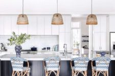 17 rattan stools with blue and white chair covers highlight the nautical design of the kitchen
