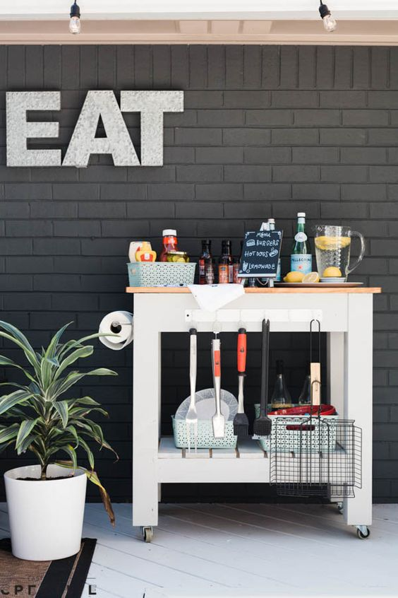 a drink station with various cutlery for grilling is enough for small outdoor spaces
