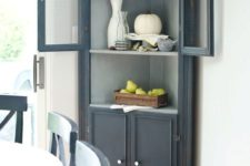 18 a graphite grey corner cabinet for storage and displaying any decorative objects