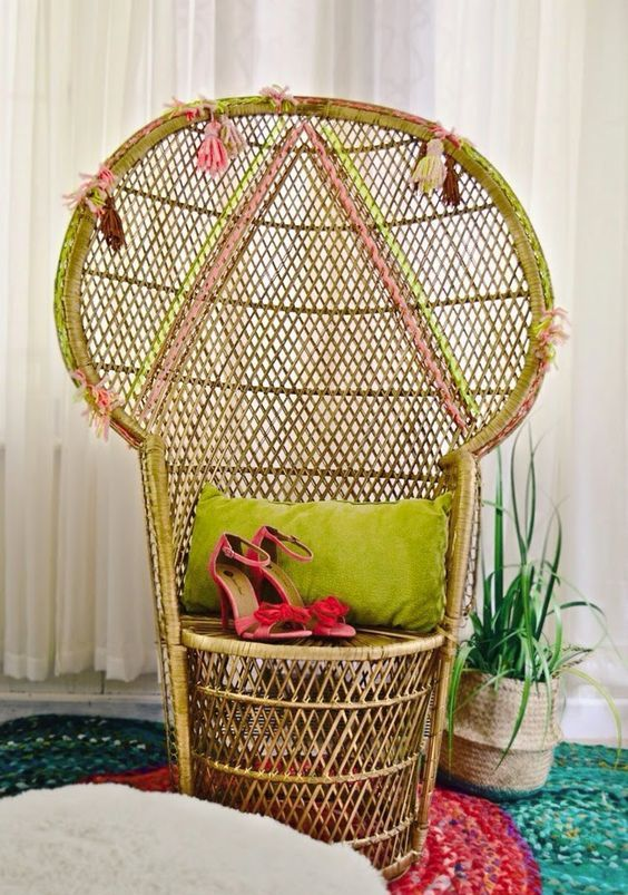a peacock chair with neon touches, geometric patterns done with yarn and colorful tassels