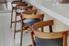 18 bold wood and leather stools spruce up a neutral space and add a bit of drama to the kitchen