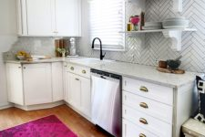 19 a contemporary white kitchen with stone countertops and white skinny tiles highlighted with black grout looks very nice