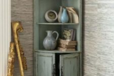 19 a distressed mint colored corner cabinet will add a refined touch to your space