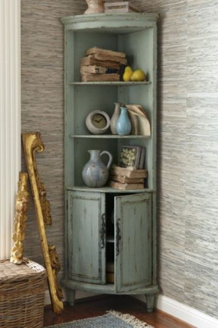 a distressed mint colored corner cabinet will add a refined touch to your space