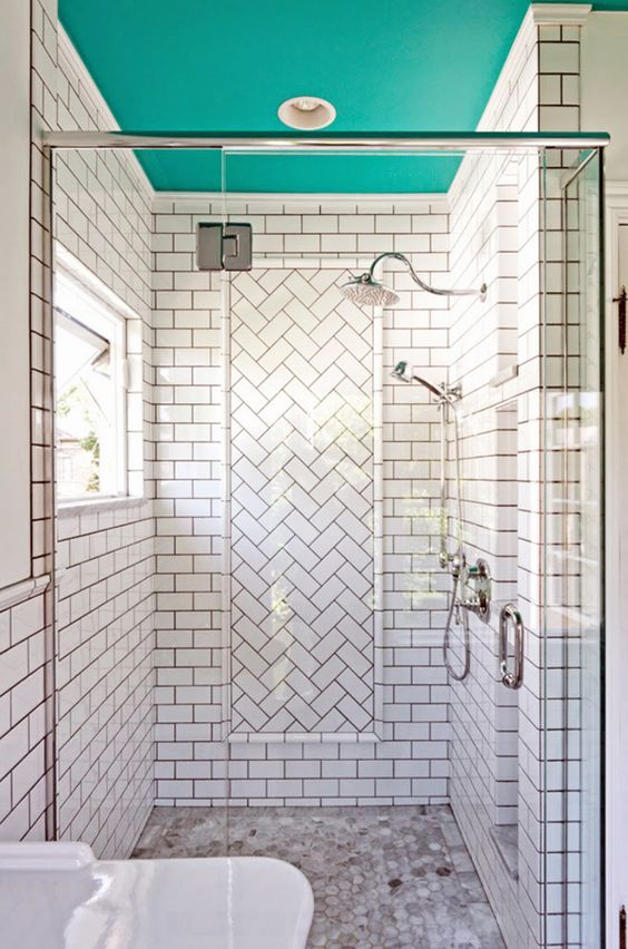 a white shower space with a turquoise ceiling that brightens up the space and makes it more unusual