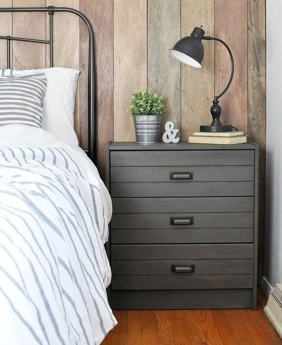 an IKEA Rast dresser hacked with grey paint, planks and vintage handles for an industrial meets rustic bedroom
