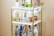 21 an IKEA Bygel cart hacked with gold spray paint and marble contact paper is a chic and glam piece