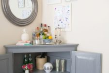 21 use a corner cabinet to make up a stylish home bar with plenty of storage