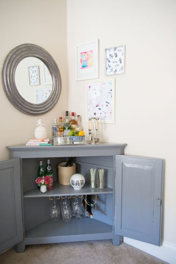 use a corner cabinet to make up a stylish home bar with plenty of storage