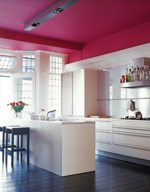 a contemporary kitchen in white with a fuchsia ceiling as an only and overall color accent in the space