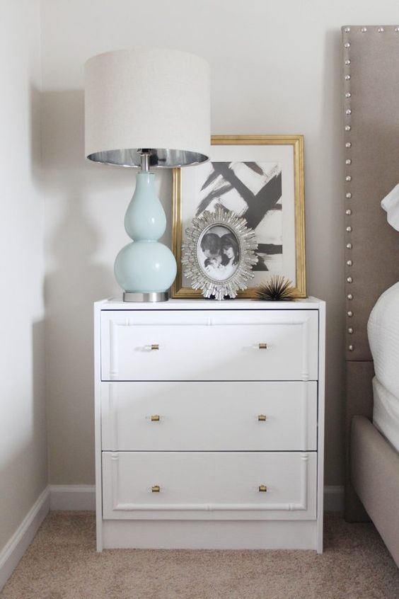 an IKEA Rast dresser redone with inlays and metallic knobs for a glam feel in your bedroom